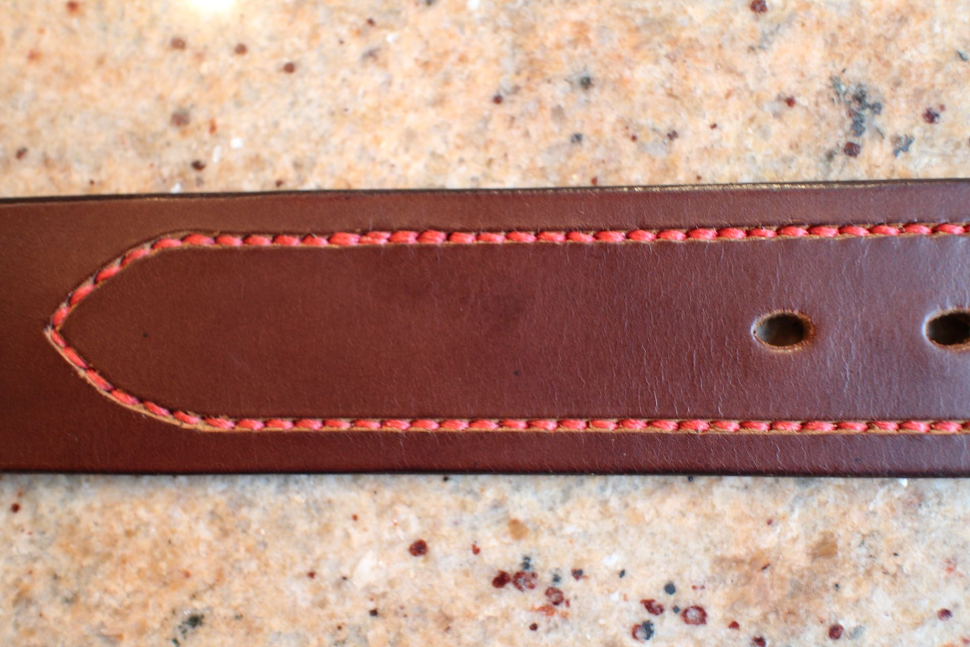Close up of hand saddle stitching.sunk below the surface