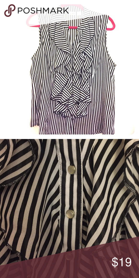 Sleeveless Black & White striped blouse Black and white striped blouse with classic billowing down the buttoned front. Perfect for a solid pants suit. White pearly colored bubble buttons. Worn twice. Cato Tops Button Down Shirts