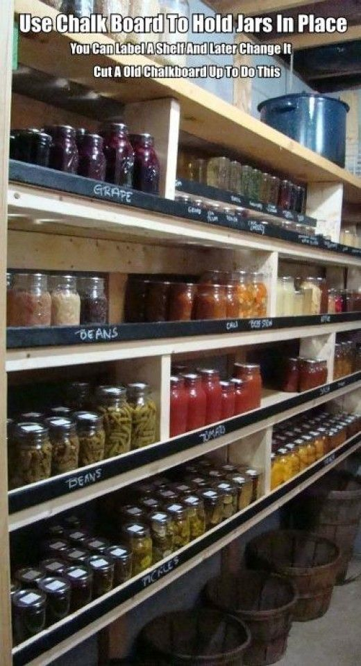 Cut up a old chalk board in narrow strips to hold your jars in place and you can also label each shelf this way.
