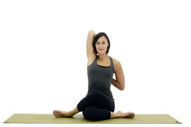 cow face pose offers serious stretch for the hips  seated