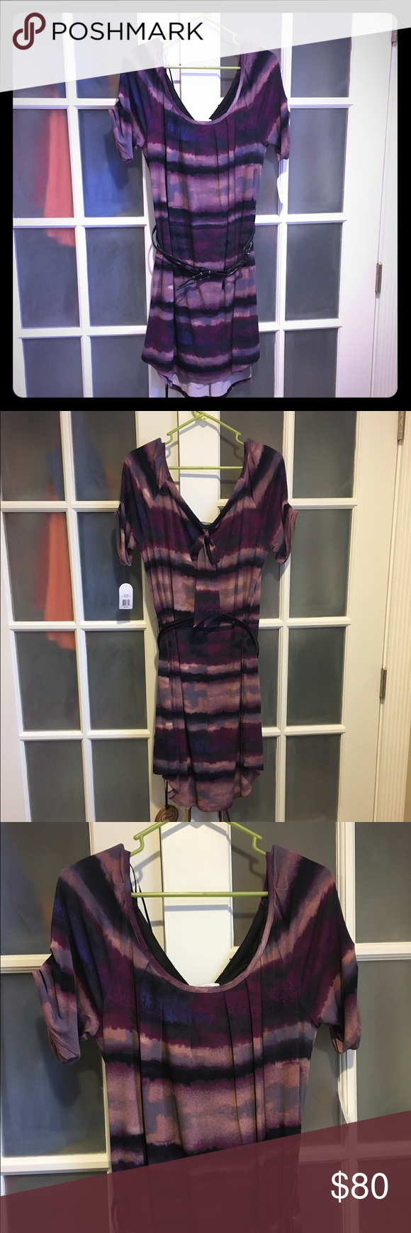 """Jessica Simpson Dress This is a beautiful dress by Jessica Simpson. Tags attached! Light and dark purple swirl design. Attached black belt. U-neck. Short sleeves. Flowy. Back top hem ribbon for design. Inside black lining. Pretty to wear to almost any occasion! No holes or stains. 37"""" long and 17"""" wide. 95% polyester and 5% spandex. Says dry clean only but I'm sure you can wash cold and hang dry. Comes from a smoke free home. **No PayPal and may bundle** **NO TRADES** Jessica Simpson Dresses"""