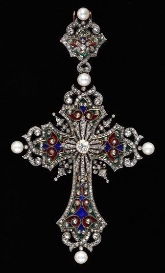 AN ANTIQUE ENAMEL, DIAMOND AND PEARL CROSS PENDANT. By Charles Riffault (probably, maker) and Boucheron (maker). The ornate cross of green, blue and red enamel, diamond scroll and collet detail with central diamond cross motif and pearls at the cardinal points, mounted in silver and gold, circa 1875. #Boucheron #antique #pendant