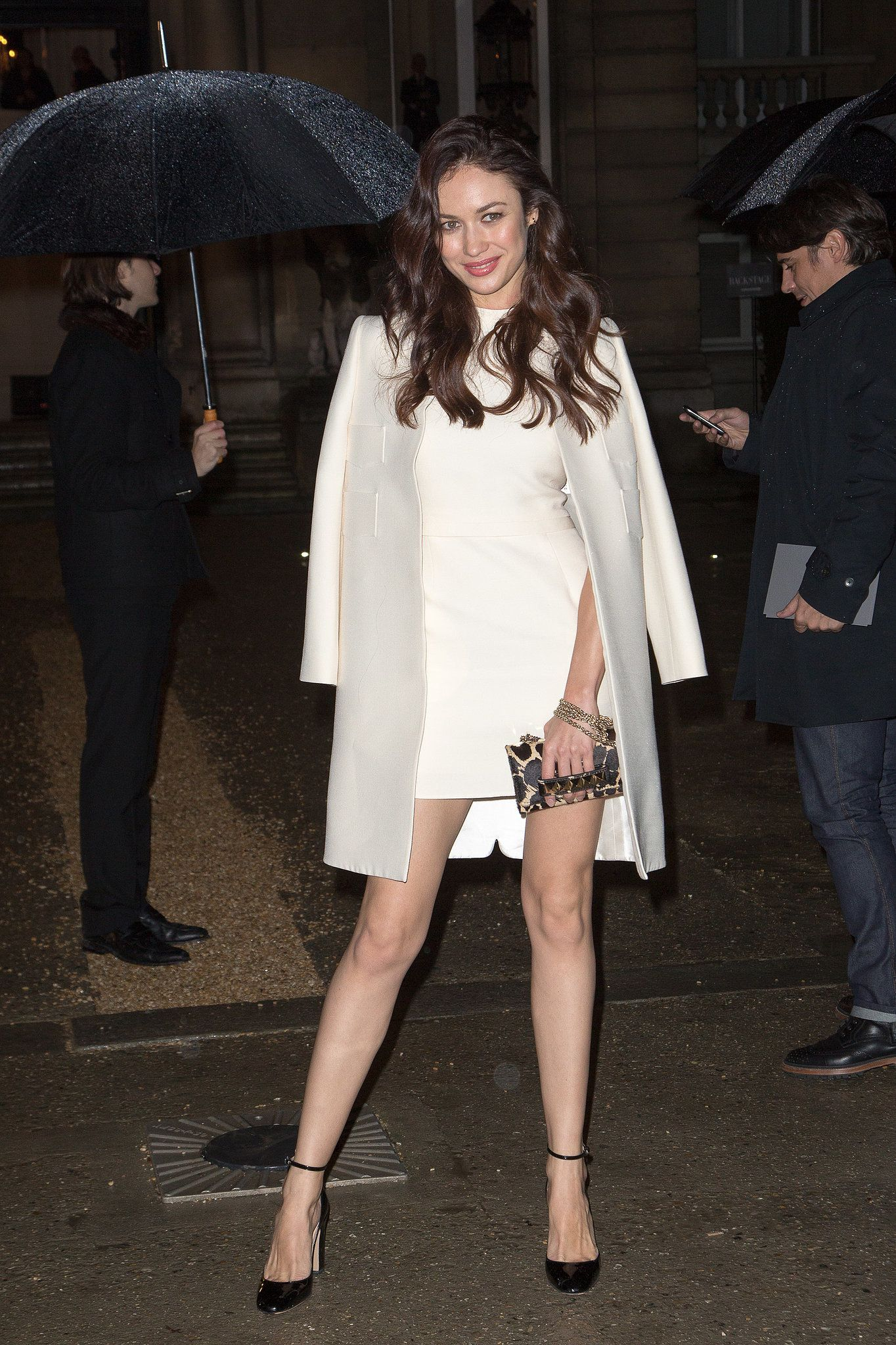177eba80fb70 Olga Kurylenko braved the rain outside Valentino in a crisp white shift.