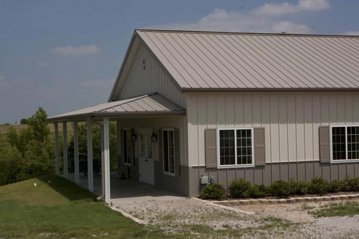 Ideal 30 x 50 metal building home w wrap around porch hq for Pole barn with porch