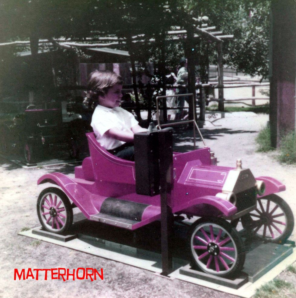 These little cars were by the merry-go-round, They jerked you up and ...