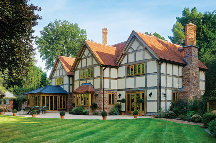 Catherine And Tony Moore Have Built A Tudor Style Four Bedroom Family Home With The Help Of Uk Oak Frame S Tudor Style Homes Oak Frame House Self Build Houses