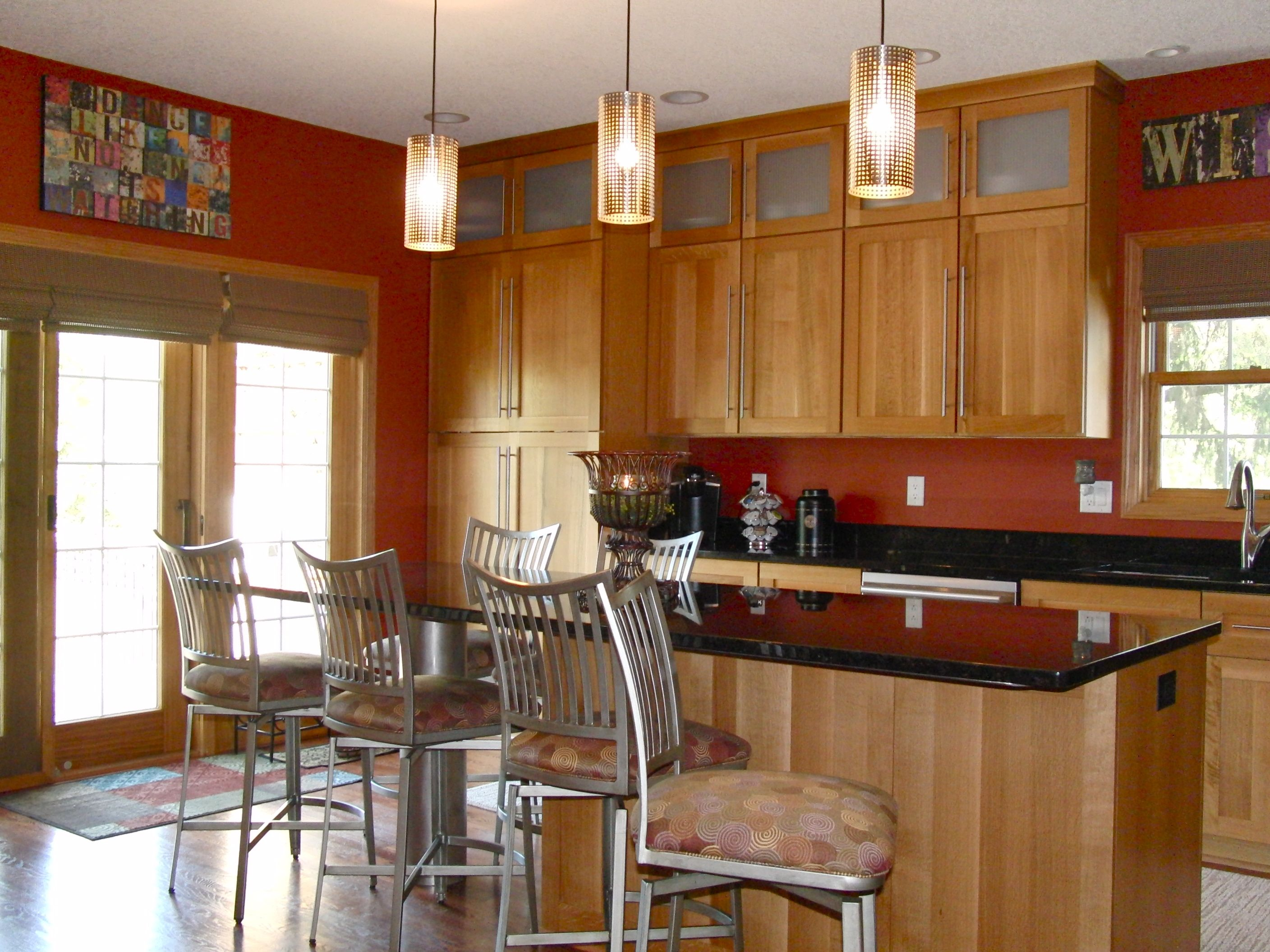 kitchen painted in a warm terra cotta color barstools. Black Bedroom Furniture Sets. Home Design Ideas