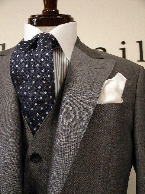 Light grey suit with navy tie