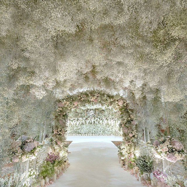 Wedluxe Media On Instagram A Tunnel Coated In Baby S Breath And Subtle Pops Of Pastel Blooms Creates A Babys Breath Wedding Wedding Tunnels Wisteria Wedding