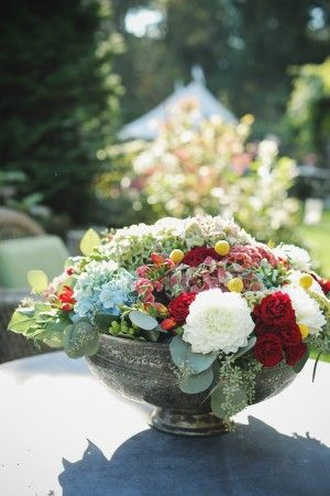 Lush floral arrangement in silver bowl | photography by http://photography.michelemwaite.com/