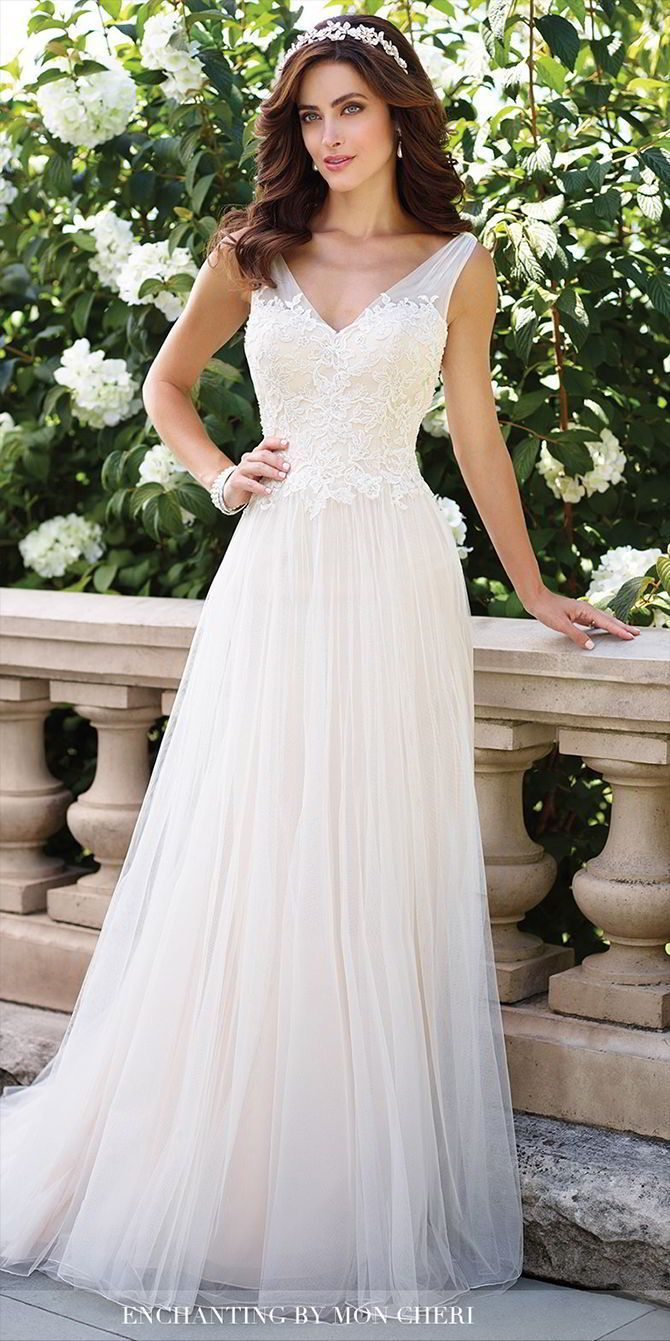 Sleeveless soft tulle and lace aline gown with gathered illusion