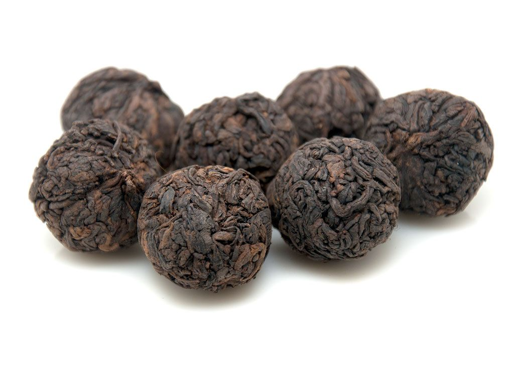 Pu-erh balls - Pu-erh tea represents a variety of fermented dark tea which is being produced only in the Yunnan province of China. This tea undergoes a long process of fermentation which is believed to be one of China's unique styles in tea production. Pu-erh is actually moderate in taste, it is a dark tea, featuring a brown to black color. It gets better with time and aged pu-erh tea is actually really sweet.