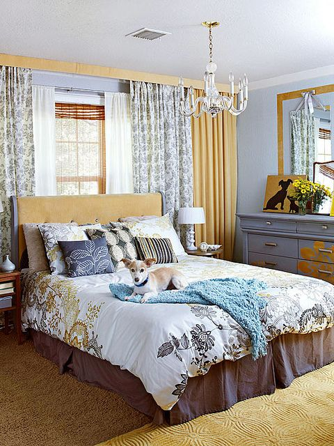 Wall of curtains framing in/behind bed Creates the illusion of a
