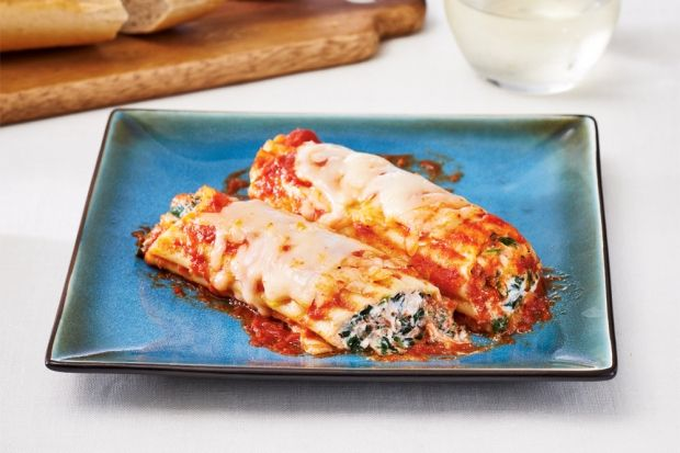 You won't believe how tasty and easy it is to make this classic dish in your slow cooker. A piping bag - or plastic bag - makes easy work of stuffing the manicotti. Serve with a tossed salad and garlic bread for an easy family-style dinner.