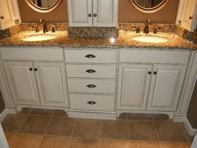 double sink vanity with center cabinet. bathroom vanities with tower storage  Double vanity center drawer stack provides ample