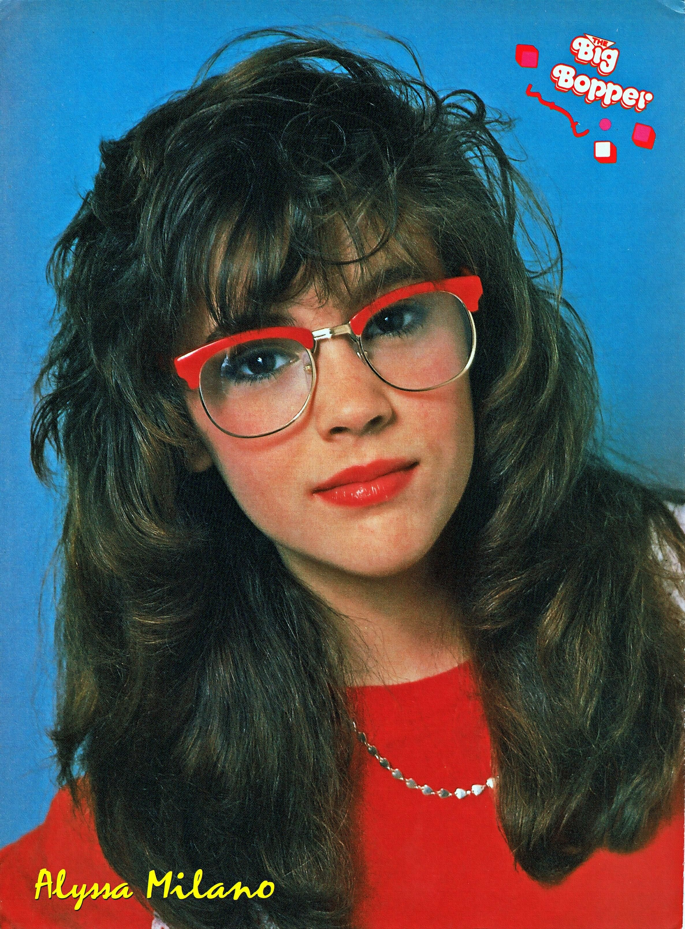Pinup Of Alyssa Milano Wearing A Red Shirt And Eyeglasses From An