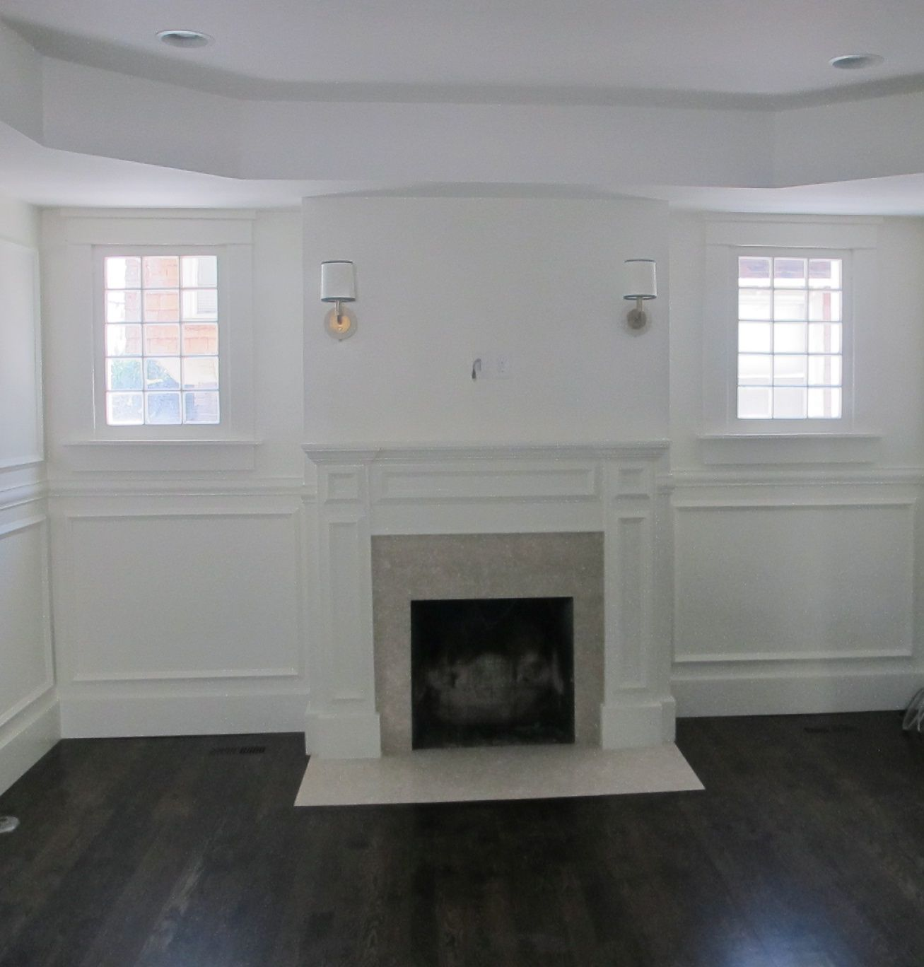 Tile Fireplace Surround With Dark Wood Floors   Interesting Use Of White  And Gray Marble.