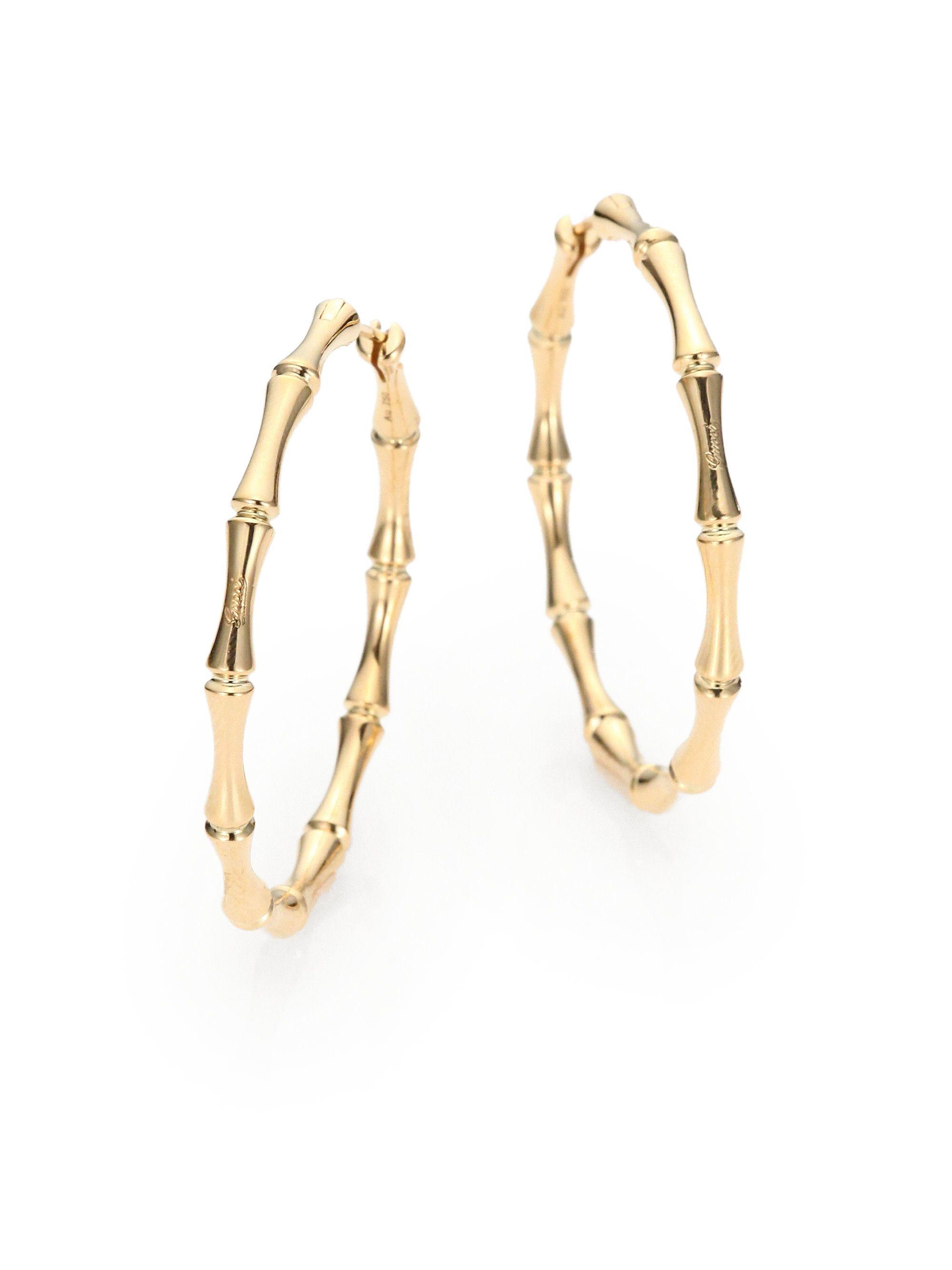 gucci earrings. gucci gold 18k bamboo hoop earrings