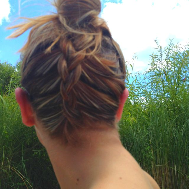 """My sister did the """"upside down French braid bun"""" to my hair at the pool! Please excuse the dirtiness lol! It actually looked really cute!"""