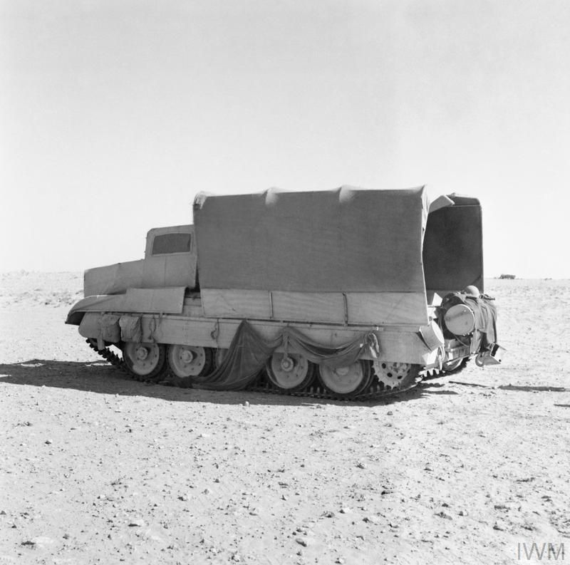 A British Crusader tank camouflaged to look like a lorry truck. North Africa. WW2 1942 [800x793]