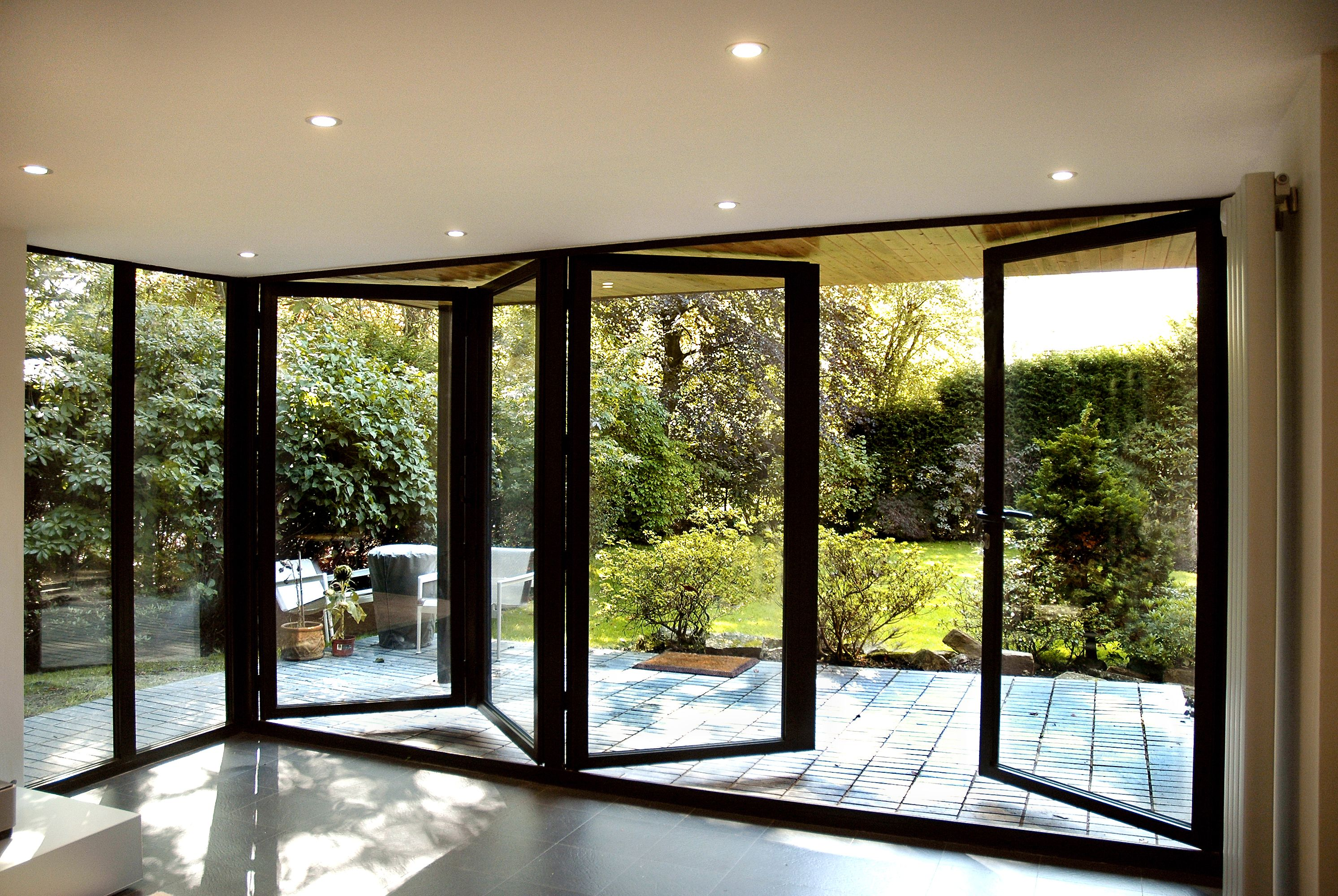 Bifold doors creating the completely open to outside for Folding patio doors