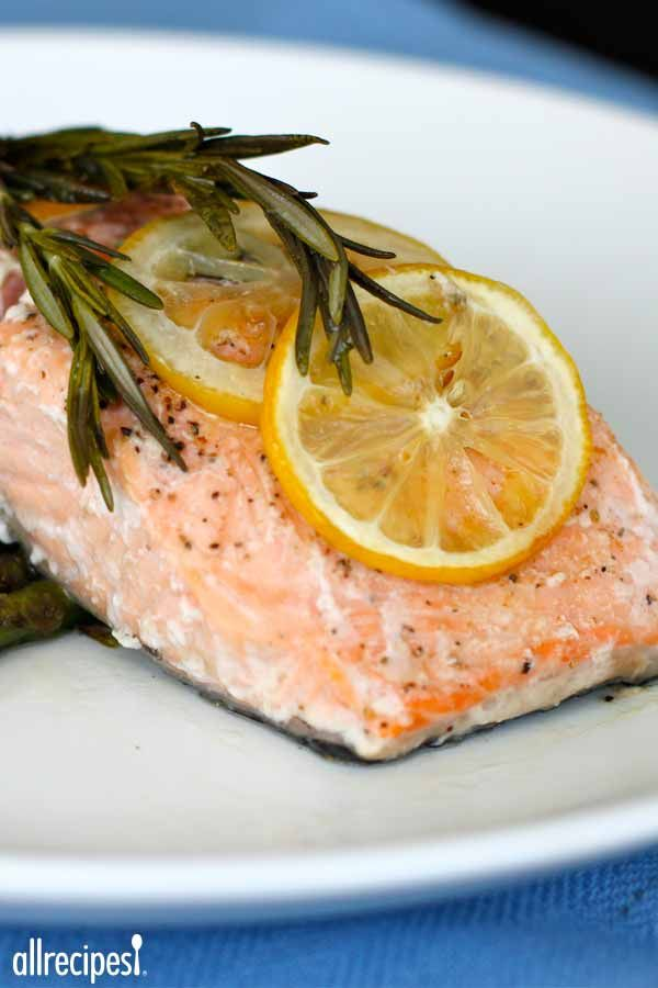 Salmon fillets are baked with lemon, rosemary, olive oil, and coarse salt in this simple preparation for an impressive romantic meal!