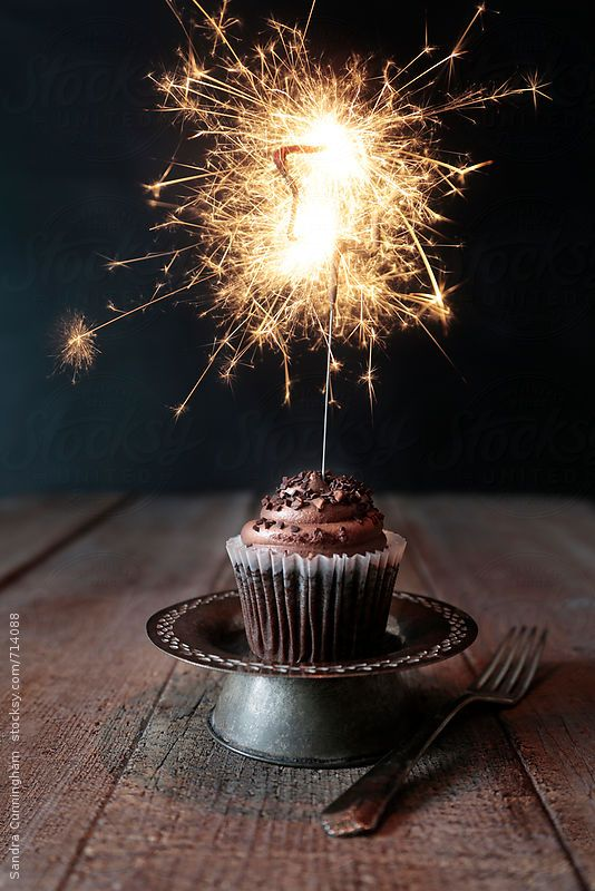 Chocolate Cupcake With Lit Sparkler On Dark Background