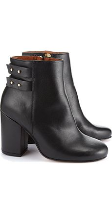 The Stinger mid-height ankle boot features contrast leather panels and silver stud detailing with straps. Heel measures approximately 3.5 inches. Zip fastening at side, round toe, 100% leather.