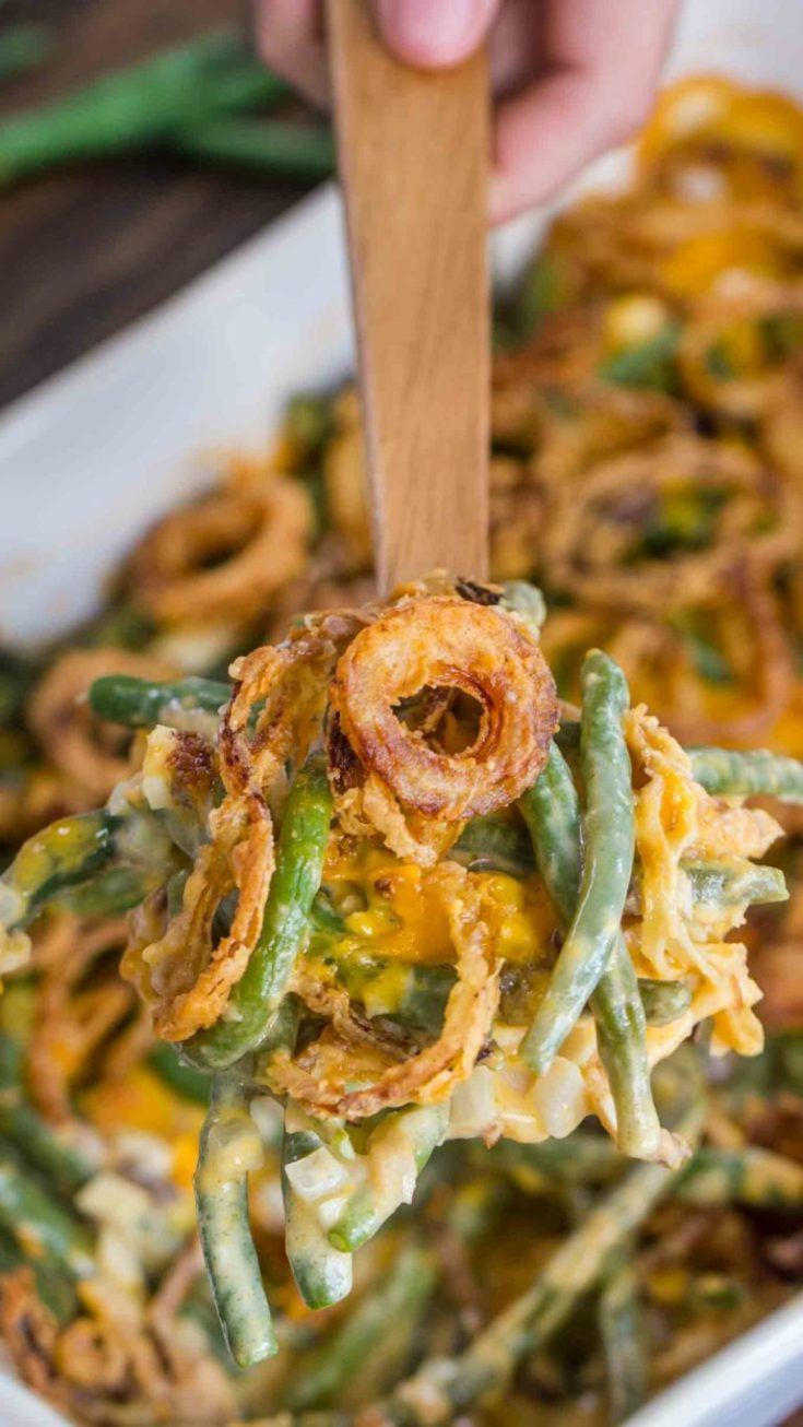 Green Bean Casserole is the ultimate comfort food, loaded with fresh green beans, cream of mushroom soup, Cheddar cheese, and french fried onions. #greenbeancasserole