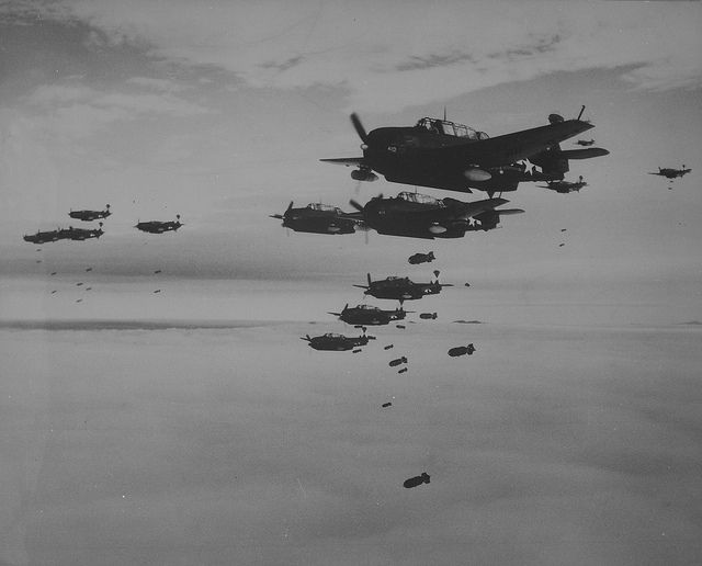 TBM Avenger bombers and Curtiss SB2C Helldivers from American aircraft  carrier USS Essex (CV-9) dropping the bomb on the Japanese city of  Hakodate July 1944.