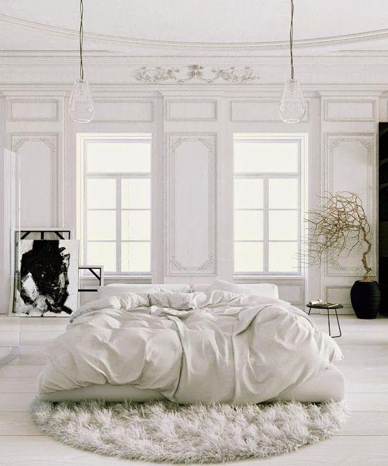 Soft white bedroom in a Parisian apartment | #bedroom #parisianstyle #whiteinterior #shadesofwhite