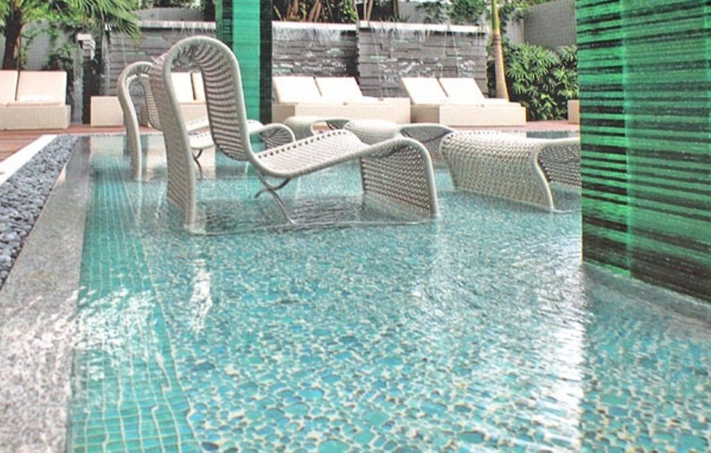 elegant swimming pool ideas with unique pebble tile design