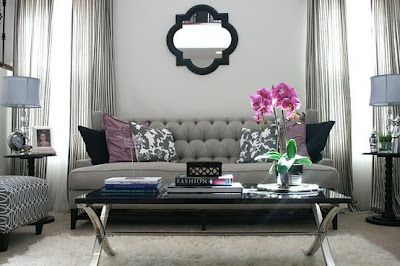 Good N This Room The Light Grey Walls, Sofa And Side Lamps, Receive A Punch Of  Color With Fresh Fuchsia Flowers And Purple Cushions.
