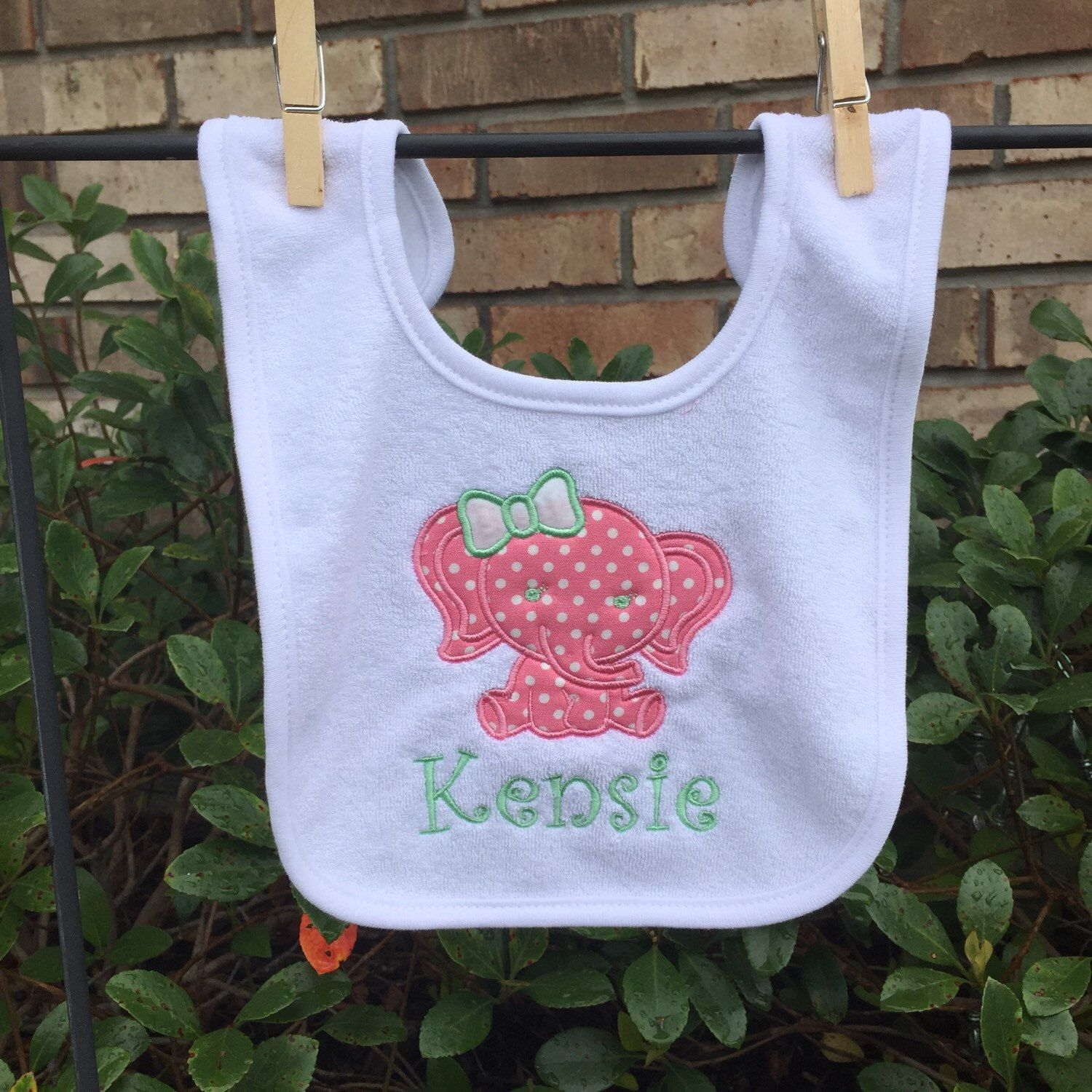 A personal favorite from my Etsy shop https://www.etsy.com/listing/247706582/personalized-bib-with-elephant-applique
