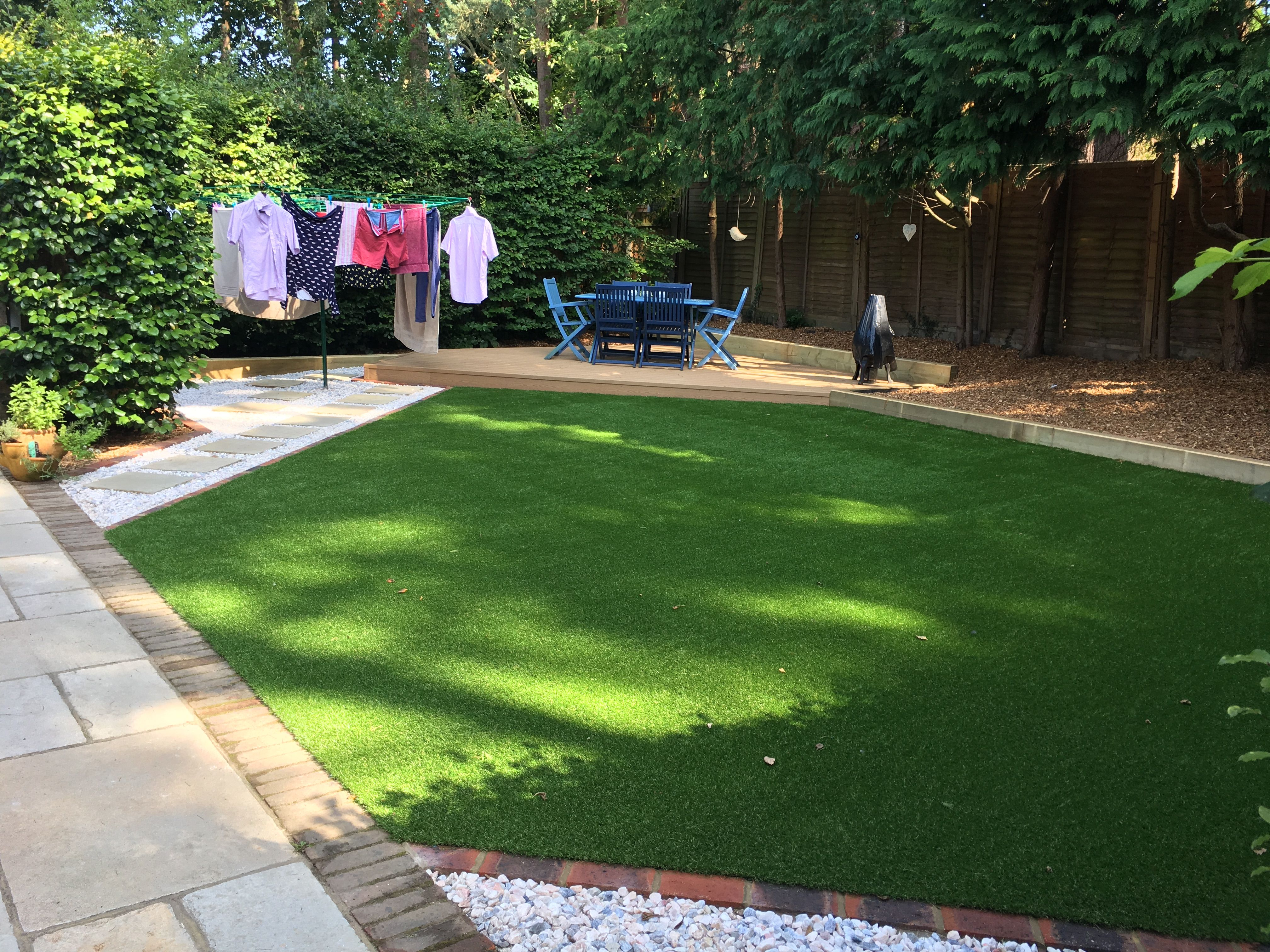 A low maintenance garden incorporating a shaped patio area ...
