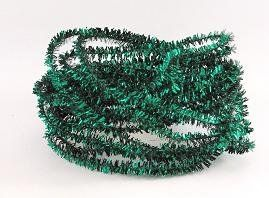 Dollhouse green tinsel garland decorating a dollhouse for st