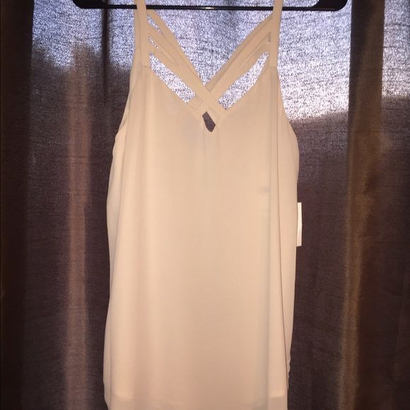 Chiffon Off-White Tank Top Chiffon Off-White Tank top with crisscross deign in front and back. NEW with tags! Tops Tank Tops