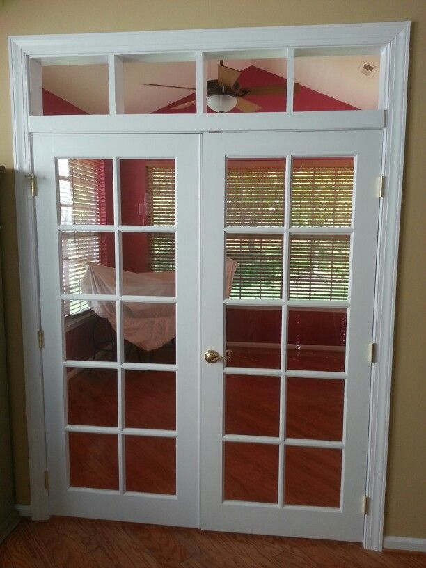 Custom transom, framing, and trimming of french doors with RWB.