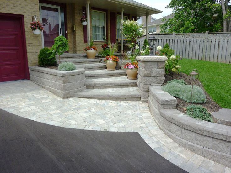 Paver Front Porch With Stairs And Raised Garden Beds And Pillar