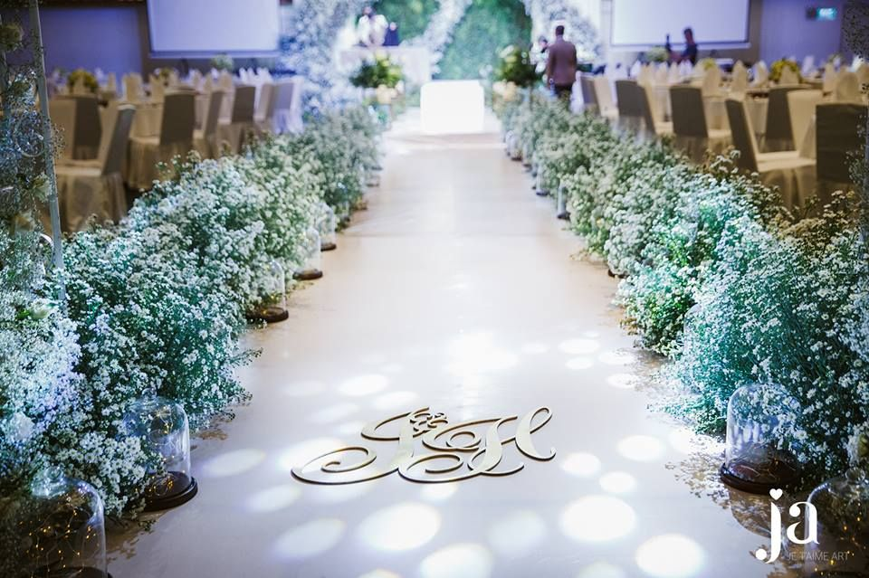 The Aisle Was Decorated By Thousand Of Little Cutie Aster Flowers With Their Pure White Tr Wedding Aisle Decorations Enchanted Forest Wedding Wedding Flowers