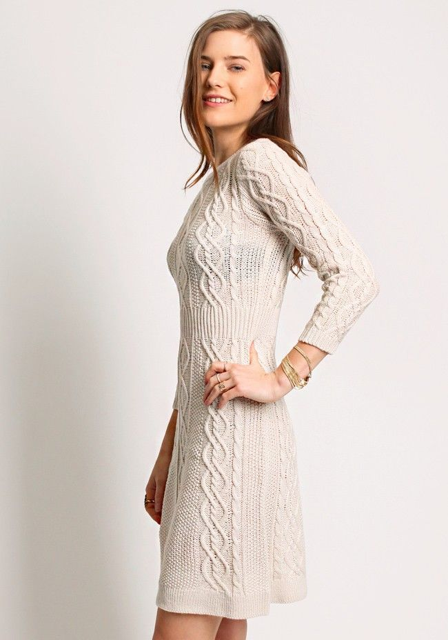 Beige dress with cable knit patterns, round neckline and 3/4 sleeves.