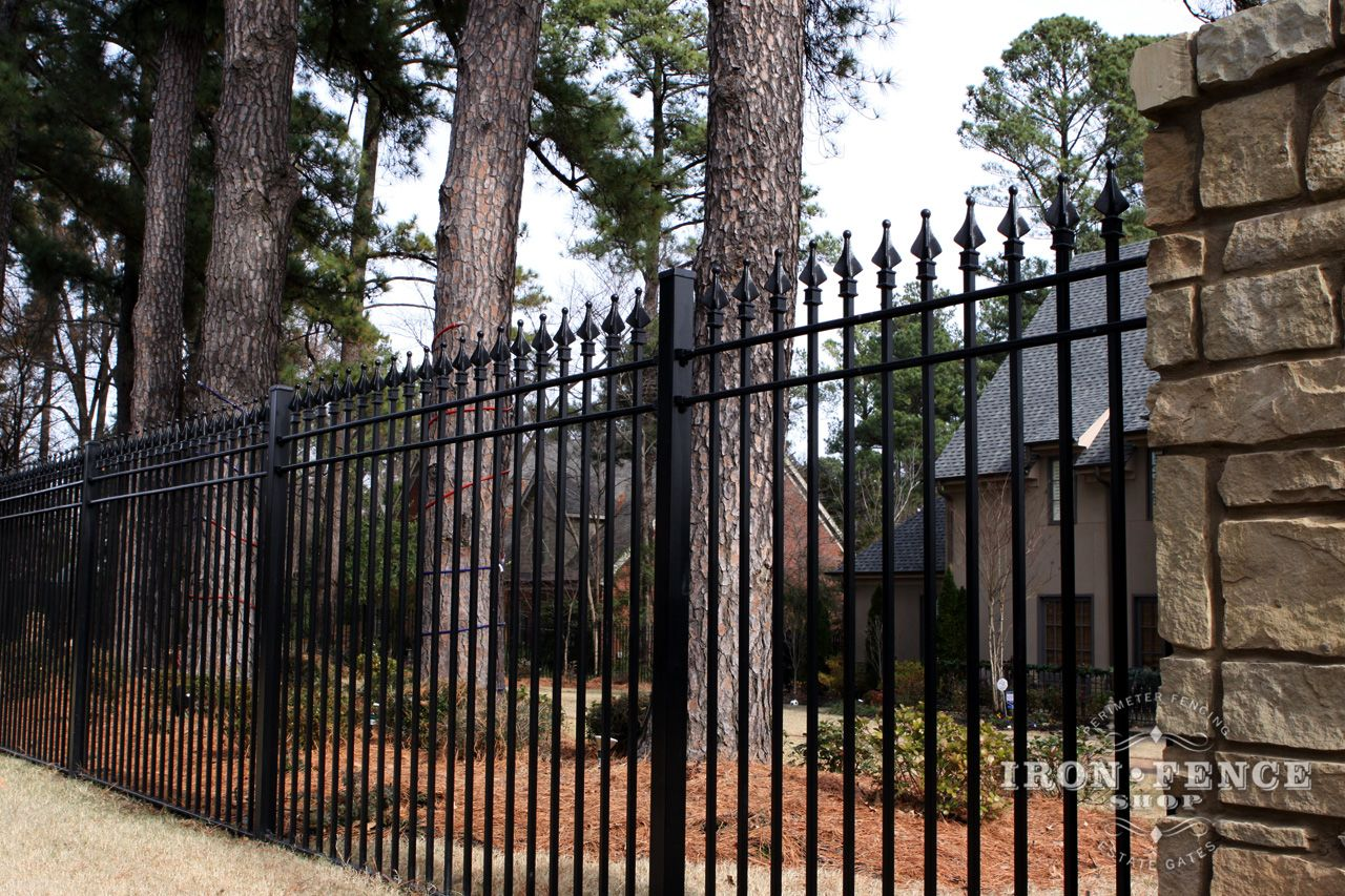 An Up Close De Ed View Of Our Arcadian 6 Foot Stronghold Iron Fence With A Brick Post And A Wonderful Landscape