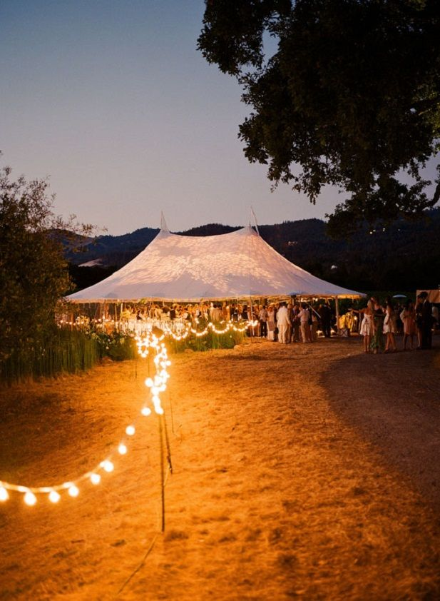 Cozy and romantic outdoor wedding decor with lights