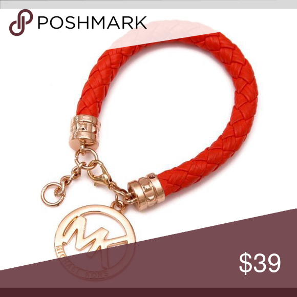Michael Kors bracelet Only worn once. Flawless in excellent condition. Hand chain circumference 19cm  Pendant Size Size 32mm * wide 25mm high  Bracelet weight 19g. Color is an orangish/red Michael Kors Jewelry Bracelets