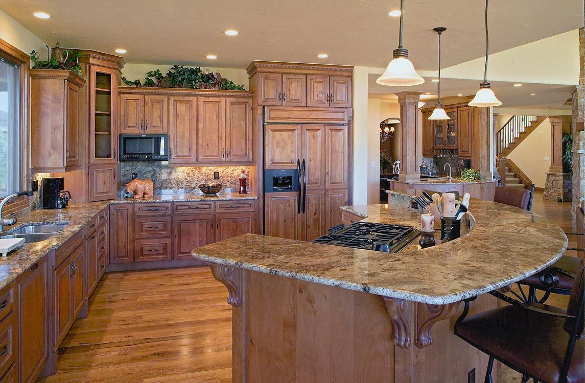 Hickory Kitchen Island Matches Colorado Style With Granite Raised Bar And Cabinets
