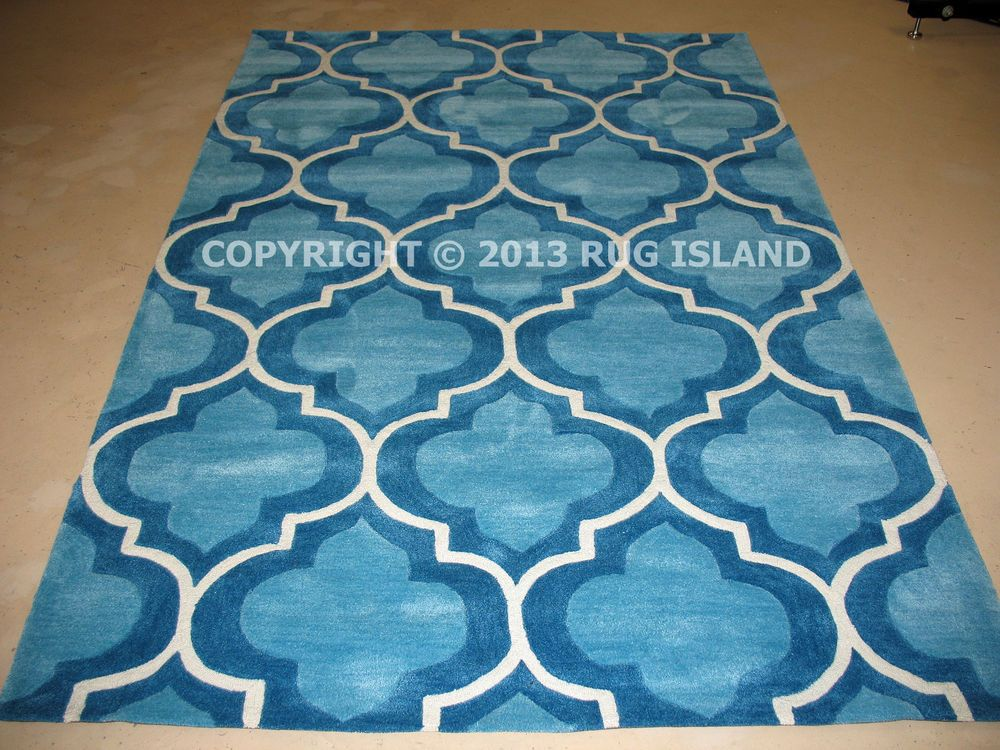 Expertly Hand Tufted from Polyester/Acrylic fibers, this rug will not shed  like wool rugs but is just as thick and plush. At Rug Island, we believe in  ...