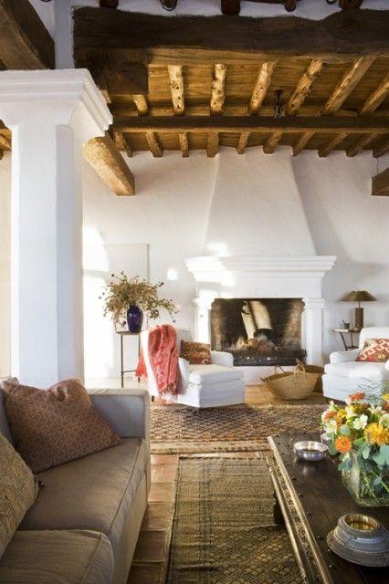 ibiza island style Beach house, natural hues, wood beams, Persian tribal rugs