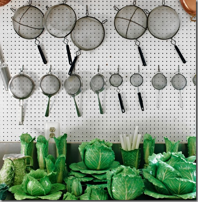 Strainers and cabbageware in the kitchen of C.Z. Guest.