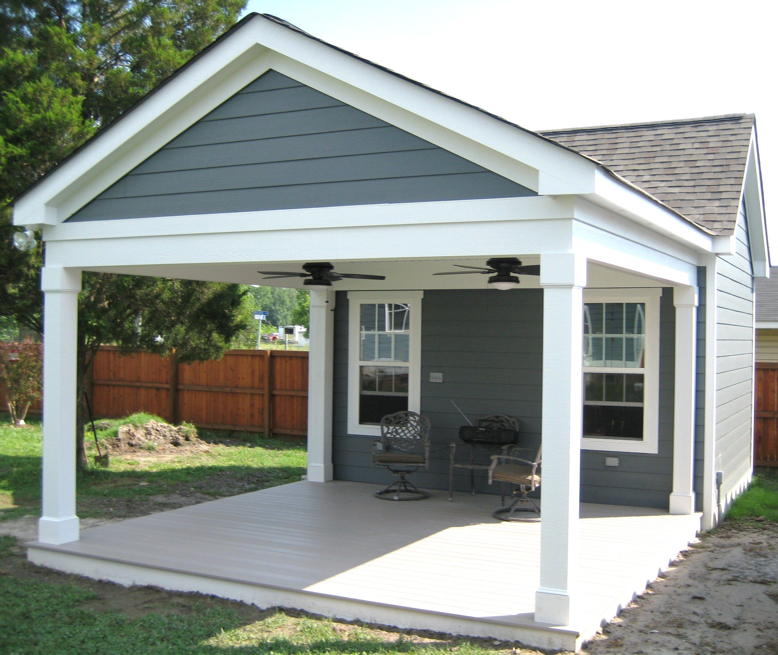 garage with porch outbuilding with covered porch