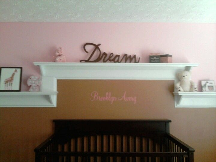 I love the shelve idea. Brown and pink baby room
